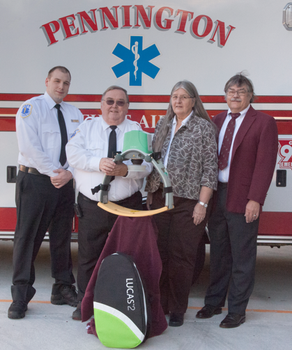 Pennington First Aid Squad Captain Jack Ferrara, President Daniel Boone, with Lucas 2 mechanical CPR device purchased with funds donated by Bonnie Schmitt and Dr Kirk Schmitt